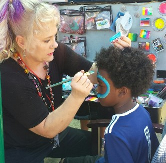 Student getting face painted at the ESE Carnival